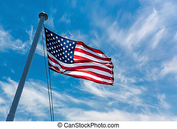 American Flag - American flag flying against a blue sky