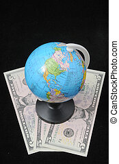 Globe and Money - Round Globe and Money on a Dark Backgruond