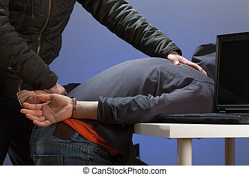 Arresting a hacker - An overpowered hacker being arrested by...