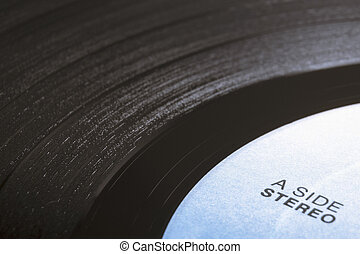 vinyl disk fragment with stereo label