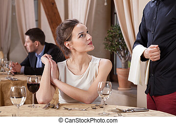 Woman ordering meal in a restaurant, horizontal
