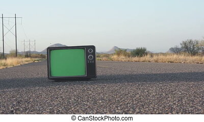 Retro TV on Highway Dolly - Dolly shot of a retro TV with a...