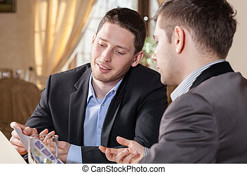 Business conversation in restaurant - Horizontal view of...