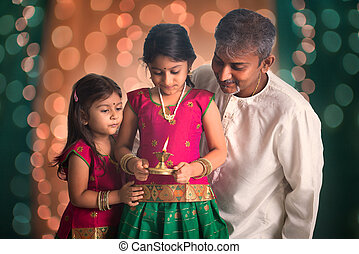 indian family fagther and daughter celebrating diwali...