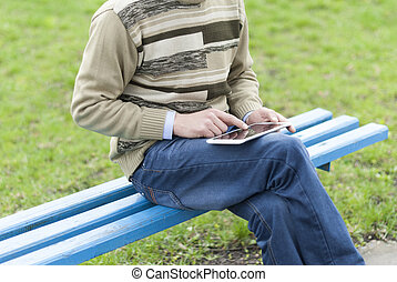 Man with tablet computer in hands.