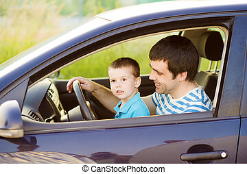 Father and son driving car - Young father with his little...
