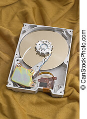 harddisk - open harddisk on golden fabric background