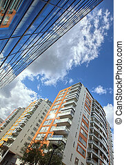 modern apartments with a blue sky