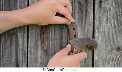 hand hammer horse shoe - Closeup of man hand with retro...