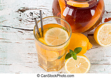 ice tea - Lemon, slice and mint ice tea on wooden table....