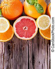 Fresh fruits on wood. - Fresh lemons, grapefruits and orange...