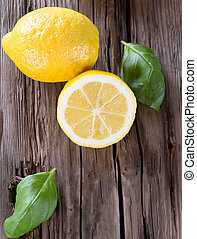 ice tea - Lemon, slice and mint ice tea on wood background....
