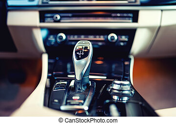 automatic gear shifter in a new, modern car. Car interior...