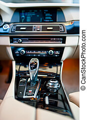 automatic gear shifter in a new, modern car Car interior...