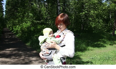 Mother playing with baby in park
