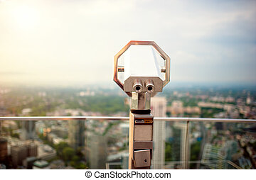 hand held telescope on top of skyscraper at observation deck