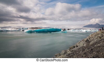 blue icebergs floating - 4k version of Time lapse of blue...