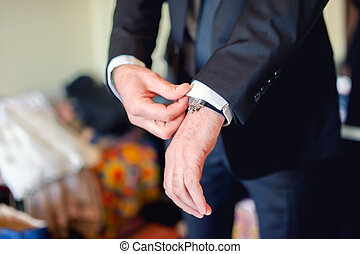 Close up of elegant man, groom hands with suits, ring,...