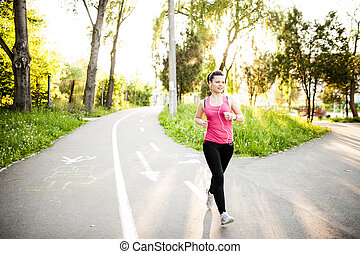 Portrait of a smiling active female runner. Fitness female...