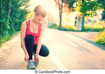 woman running workout on spring sunny sunset Fitness girl...