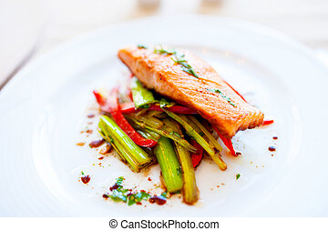 Smoked salmon with fried vegetables as main dish at local...