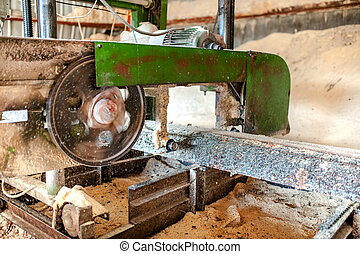 industrial wood production factory - close-up of band saw