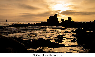 Corona Del Mar Beach Sunset - Waves crashing against rocky...