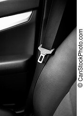 close up safety belt in a rear seat of modern, luxurious car