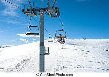 Chairlift on ski slope in mountain resort