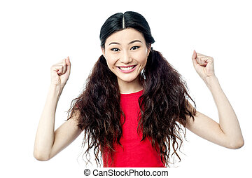 Cheerful woman with clenched fists - Excited young girl...