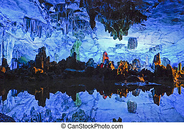 Stalagmite cave with reflecting pool - Reed Flute stalagmite...