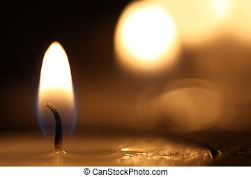 Burning flame - Candle burning with black background in...