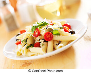 penne pasta salad with olives, tomatoes, and basil