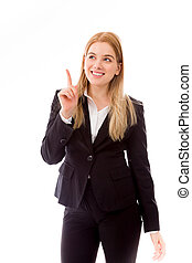 Businesswoman pointing finger upward smiling - Young adult...