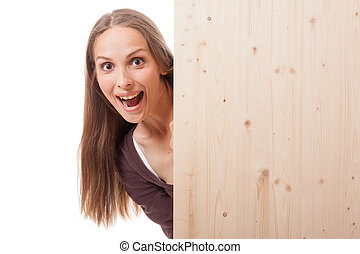 Woman behind a wooden board