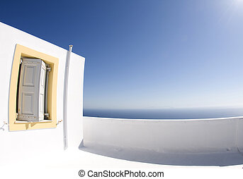 greek island architecture overlooking the aegean sea -...