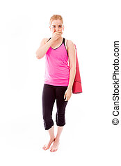 Young woman carrying exercising mat with hand over her mouth...