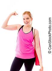 Young woman showing off her muscle - Young adult caucasian...