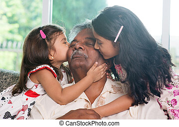 Grandchildren kissing grandparent - Portrait Indian family...