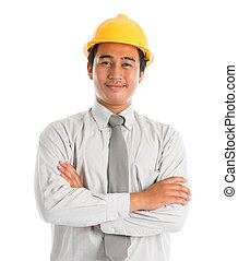 Asian male wearing yellow hardhat. - Close-up of an Asian...