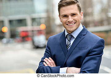 Smiling businessman posing for the camera - Confident male...