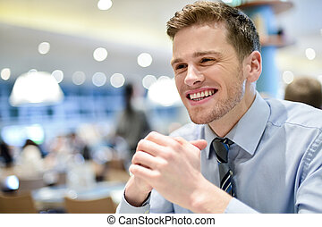 Corporate guy awaiting his order - Business guy waiting for...