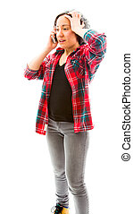 Young woman talking on mobile phone with her hand on her...