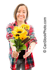 Young woman offering bouquet of sunflowers and smiling