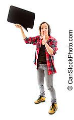 Young woman holding a blank speech bubble with finger on...