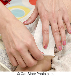 Waxing with wax strips - Beautician while making waxing with...
