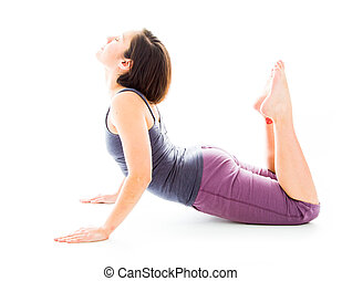 Young woman practicing yoga in cobra pose