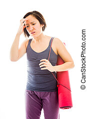 Young woman suffering from headache with carrying exercise...