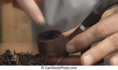 man to fill his pipe tobacco