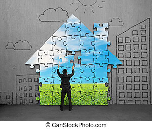 Assembling house shape puzzles on wall - Assembling house...